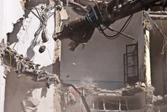 Indrustrial machine demolishing a building Stock Photo
