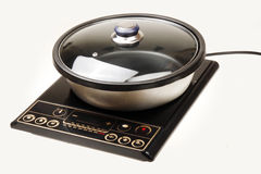 Induction cooker. With soup pot on white Royalty Free Stock Images