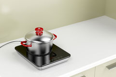 Induction cooktop and cooking pot Royalty Free Stock Photo