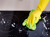 Induction hob cleaning Royalty Free Stock Image