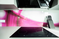 Induction hob in modern kitchen. View of induction hob in modern kitchen Royalty Free Stock Photos
