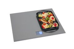 Induction hob with roast chicken Stock Photography