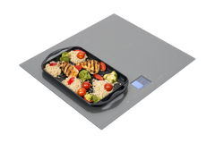 Induction hob with roast chicken Stock Image