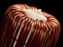 Inductor detail. Detail of a electronic conductor in dark back royalty free stock photos