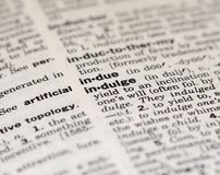 Indulge. Induge Definition from old Dictionary Stock Photo
