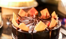 Indulge your. A lovely Holiday Cake artisinaly baked with dark choco llatr and white chocolate accent stock photo
