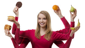 Indulge yourself. Woman with six arms holding fruit and cakes in each hand stock images