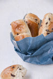 Indulgence: paper bag with brioche mini loaves Stock Photo