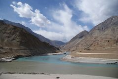 Indus River meets Zanskar river in Himalayas. Indus river in Himalaya mountains, Ladakh, India Royalty Free Stock Images