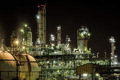 Industrail lighting at night. Petrochemical and lighting at night background Stock Images