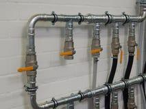 Industriële loodgieterswerkpijpen Stock Foto's