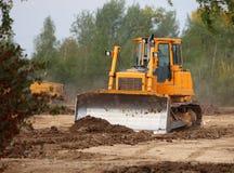 Industriële Technologieën: bulldozer op een bouwwerf Stock Afbeeldingen