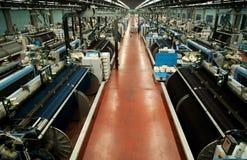 Industria textil (dril de algodón) - tejiendo Foto de archivo