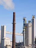 Industrial. Plant with smoke coming from the smokestack Stock Images