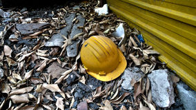 Industrial accident. An accident at a construction site in the country side. A helmet is left to represent the death and dangerous Stock Images