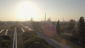 Industrial aerial view of big modern oil and gas plant or factory with sun and lens flare stock video