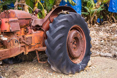 Industrial agricultural scene of abandoned old rusted and dusty tractor Royalty Free Stock Photo