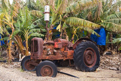 Industrial agricultural scene of abandoned old rusted and dusty tractor Stock Photography