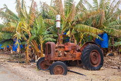 Industrial agricultural scene of abandoned old rusted and dusty tractor royalty free stock image