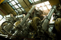 Industrial air compressors. Old industrial air compressors in closed factory power plant Stock Photos