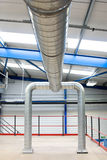 Industrial air-conditioner pipes. Plant interior and industrial air-conditioner metal pipes Stock Photography