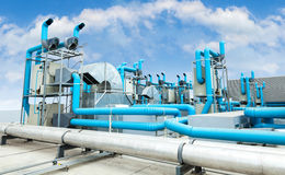 Industrial air conditioner. On the roof with blue sky Stock Image