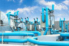 Industrial air conditioner. On the roof with blue sky Stock Photo