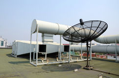 Industrial air conditioner and satellite dish. On the roof Stock Photos