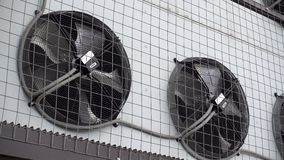 Industrial air conditioner unit fan rotating.