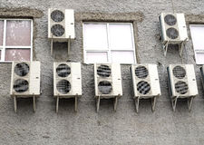 Industrial air conditioning hungs mounted on rear wall of building Stock Photos