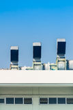 Industrial air conditioning and ventilation systems on a roof. On blue isolated Royalty Free Stock Photos