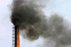 Industrial air pollution. Air pollution - smoke billowing from chimney Royalty Free Stock Photos