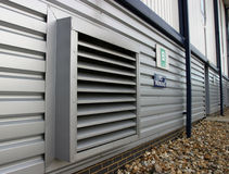 Industrial Air Vent. Air ventilation detail on the side of a modern factory stock photography