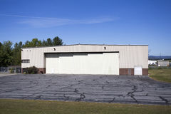 Industrial Airplane Hanger. An industrial airplane hanger at a local regional airport Stock Photography