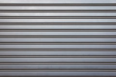 Industrial Aluminum Door Texture. Metal Security Roller Door Background Stock Photo