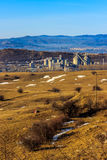 Industrial area in in the background with smoking factory chimneys, forest and mountains Royalty Free Stock Photo