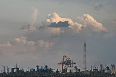 Industrial area. Cranes by the sea, in industrial area Stock Image