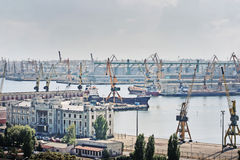 Industrial area. Cranes by the sea, in industrial area Stock Images