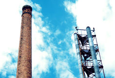 Industrial area. Refinery plant with smoke stacks, industrial site Royalty Free Stock Image