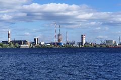 Industrial area on the shore of the reservoir stock photography