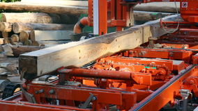 Industrial automated machine cutting wood logs stock video footage