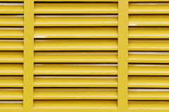 Industrial  background. Yellow cooling grill for anindustrial engine on a conveyor belt machine at a quarry Royalty Free Stock Photos