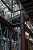 Industrial background, old abandoned factory hall with stairs and day light. Industrial background, big old abandoned factory hall with stairs and day light royalty free stock photos