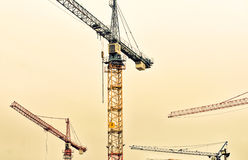 industrial background with construction cranes Stock Photos
