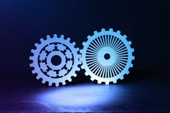 Industrial background. Gear in blue spotlight, new innovation and technology idea.  royalty free stock photo