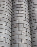Industrial background of grain bins. Three rows of metal grain bins with metal rivets- Industrial Background Royalty Free Stock Images