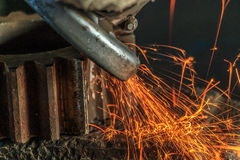 Industrial background, industry, Sparks from grinding machine in Royalty Free Stock Photo
