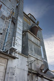 Industrial background, old grain elevator Stock Photos