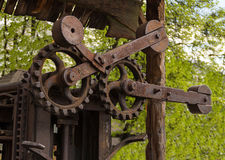 Industrial background rusty old large toothed gear mechanism. Processing timber Royalty Free Stock Image