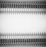 Industrial background with a steel thread on the stud on grey background monochrome photo Royalty Free Stock Photos